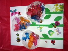 Toddler painted flower craft with cupcake holders, foam sticky sheets and bug stickers