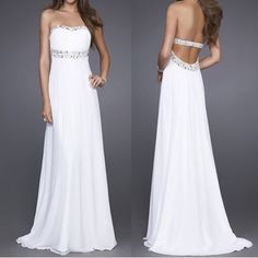 Beach wedding dress. Love the open back and strapless bust. A bit too plain though.