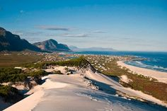 Silver Sands Beach, Betty's Bay, South Africa    Sand-boarding is an ideal sport for sunshine lovers who crave an adrenaline rush.