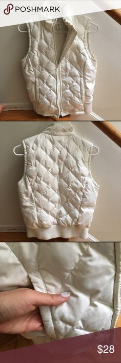 Quilted Vest Off-white quilted vest with fleece lining. Soft, comfy, and will keep you warm. 😊 . Minimal piling at bottom cuff (see photo) that can be plucked off, but still in great condition! LOFT Jackets & Coats Vests