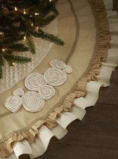 Tree skirt: a nice break from the traditional one-fabric tree skirts; love the details