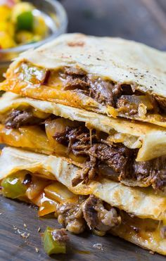 Spicy Beef Quesadillas Caramelized onions and peppers are combined with chipotle peppers and crushed red pepper flakes to flavor and spice these crispy, cheesy quesadillas. Ketogenic Recipes, Healthy Recipes, Beef Recipes, Cooking Recipes, Leftover Steak Recipes, Easy Recipes, Mexican Dishes, Mexican Food Recipes, Gastronomia