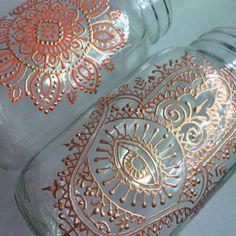 Hamsa and mandala on mason jars