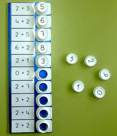 The blog post is in French but you can get the idea from the picture. The buttons on the right are milk carton caps. Clever!