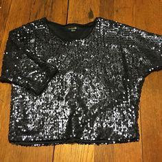 Dark blue sequin top This shirt has only been worn once. It is a beautiful dark blue color with sequins covering the whole shirt. Would be perfect for a party! Forever 21 Tops