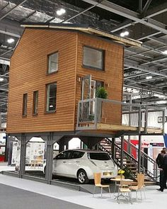 Love this idea. This is the kind of 'affordable housing' we should be building! Architect Bill Dunster has designed a range of tiny flats that stand on stilts above car parks in a bid to solve the UK's housing crisis (above) Tyni House, Tiny House Living, Casa Bunker, Casas Containers, Micro House, Small Places, Tiny Spaces, Tiny House Plans, House On Stilts Plans