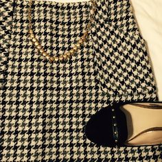 """J. Crew Wool Houndstooth Skirt Wool houndstooth mini skirt in excellent condition! Worn only a few times. The size tag fell out but I believe it is a size 4. It measures 16"""" across the waist and 15"""" in the length. A classic skirt that never goes out of style! J. Crew Skirts Mini"""