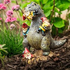 Godzilla the terrifying T-Rex Dinosaur has a taste for gnomes and is a great defender of your lawn, garden, or yard. Trespassers will think twice about stepping FOOT in your garden with this great dinosaur gnome eating statue! Gnome Statues, Garden Statues, Lawn Ornaments, Garden Ornament, Gnome Garden, Garden Fun, Herb Garden, Fairies Garden, Moon Garden
