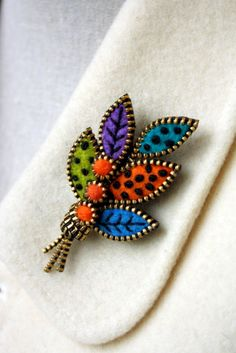Hey, I found this really awesome Etsy listing at https://www.etsy.com/listing/253200763/felt-and-zipper-multi-leaf-brooch