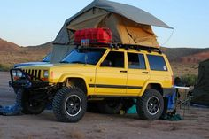 This is cool! Jeep Cherokee with roof-top tent.