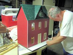 Steve building Haley's dollhouse one piece at a time for her Christmas 2011.