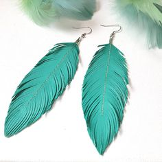Bohemian Gorgeous statement feather earrings! Lovesexton Original Hand cut and sewn pattern since 2006. Large Feathers hand cut from a soft, shiny, lightweight buttery Italian turquoise blue Lambskin leather. I have created these with intricate cuts to move and feel similar to a feather, but much are more sturdy. They go great with a dress or for a little twist on a casual look, like that perfect leather jacket! Will look great with hair up or down. Feather length measures approximately 4.5…
