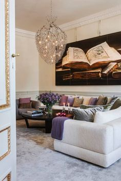 Residence of Victoria & Daniel at the Haga Palace in Stockholm : Living Room - above the couch hangs a large photograph with designs of books from the Bernadotte Library at the Royal Palace in Stockholm.