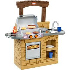"Children's play kitchen Little Tikes – a wonderful surprise for a small ""hostess"" or ""chef."" In the kit: hangers for towels and appliances, many accessories, electric stove with sounds simulating the sounds of cooking, large modern sink, faucet, oven, refrigerator, granite countertop, microwave oven and many other design options. Сute Samples Of The Little Tikes ..."