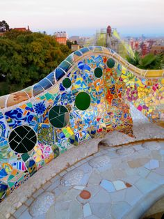 Rooftop benches with beautiful mosaic tile work at Antonio Gaudi's Parc Guell; Barcelona, Catalunya, Spain