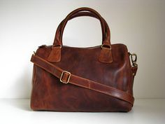 vintage style leather barrel handbag by the leather store | notonthehighstreet.com