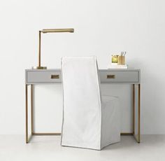 RH TEEN's Avalon Desk:The sleek lines of our collection capture the sophisticated restraint of modernism, while its polished cast-metal fittings