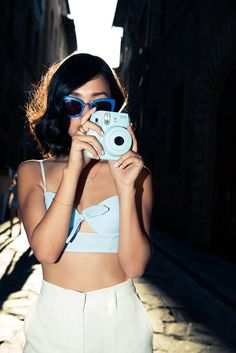 Shades of blue featuring our fav accessory: the Instax camera!