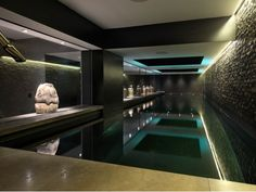 Stockinger Interior Design Inspiration - Townhouse style underground swimming pool and spa complex. Dark lighting and accents create a intense and sophisticated mood. Amazing Swimming Pools, Luxury Swimming Pools, Luxury Pools, Indoor Swimming Pools, Swimming Pools Backyard, Swimming Pool Designs, Pool Landscaping, Piscina Hotel, Moderne Pools