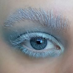 A cool icy blue eyeshadow look with fake bleached white eyebrows and white lashes - creative, artistic and editorial eye makeup art - eye makeup for blue eyes Creative Eye Makeup, Eye Makeup Art, Blue Eye Makeup, Blue Eyeshadow Looks, Eyebrows, Bleach, Makeup Looks, Lashes, Editorial