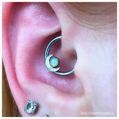 Fresh Daith with an Anatometal 18k White gold Moon and White Opal Cab on an anodized Ice Blue Niobium ring for accent! Booking for today through Sunday and really stoked to do some unique piercings! Contact myself or the shop for your appointment....