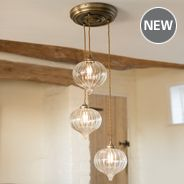 A beautifully designed triple pendant light with fluted glass shade on a circular ceiling rose. Adjustable, ideal for hanging over a dining table, kitchen island or in a hallway. Hand crafted by Jim Lawrence Glass Ceiling Lights, Ceiling Rose, Ceiling Pendant, Pendant Lighting, Brass Pendant, Chandelier, Window Furniture, Multi Light Pendant, Modern Glass