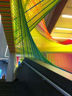 Great solution for getting art in corporate spaces. source:Megan Geckler - affaordable installation materials.weaving tape .bia2013paulina