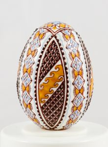 Easter egg in wax technology two-coloured blue/ochre