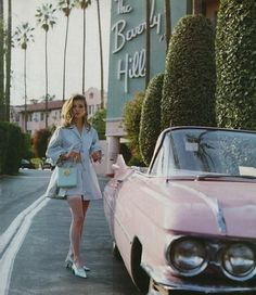 beverly hills hotel in a pink convertible
