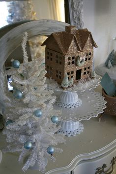 glitter house, again Hobby Lobby.  Could do the dollar Store glass candlestick glued to a plate for the display.