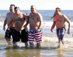 Members of the Cape May County Police and Fire Plunge Team Andrew Granero, Dave Holman and Spencer Smith assist retired Stone Harbor Police Chief Tony Solis with taking the plunge.  Granero, Holman and Smith are also officers with the Wildwood Police Department.