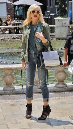 Gwen Stefani: MIlitary jacket and distressed boyfriend jeans.