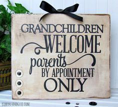Grandchildren Welcome Sign made from a painted wood board, black vinyl lettering cut out with Silhouette. Easy and creative Grandparents Day gift idea