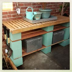Garden Potting Bench - Concrete Blocks Planks Total cost $20. (Recycled outdoor lounger for top) like the aqua painted cinder blocks.