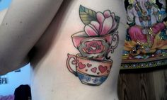 Teacups and magnolia tattoo by Guen Douglas at Salon Serpent, Amsterdam