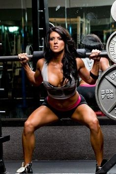 Squats with weights will give you that booty you've always wanted.
