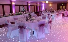 Pretty Pink theme accompanied by a Stunning Starlit White Dance Floor from London Wedding Decor - London Wedding Decor