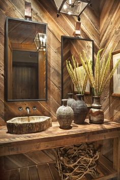 The first floor powder room is the only room in the home that is completely wrapped in reclaimed barn siding. The mirrors are by Casamidy, and the faucet is from Waterworks. Rustic Bathroom Designs, Rustic Bathroom Decor, Rustic Bathrooms, Bathroom Interior Design, Jeff Andrews Design, Cabin Bathrooms, Sink Design, Modern Rustic, Modern Classic