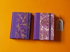mini cuadernos en A8 ideales para el bolso.interior: folios en blanco o reciclados . exterior :papel marmolado y detalle goma cierre. 9€ + gastos de envio