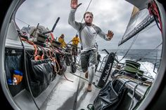 "May 22, 2015. Leg 7 to Lisbon onboard Abu Dhabi Ocean Racing. Day 5.  Luke ""Parko"" Parkinson runs for the hatch before the next wave hits in the Atlantic Ocean Matt Knighton / Abu Dhabi Ocean Racing / Volvo Ocean Race"