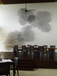 Interior of the dining room at Park Hyatt Maldives Hadahaa, designed by HBA/Hirsch Bedner Associates.