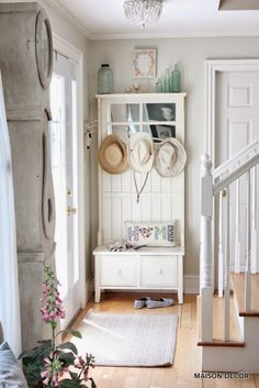 Style an entry for summer! Use whites with pretty summer colors. A HomeGoods hall tree loaded up with garden hats and an adorable hippy Home pillow makes everyone smile when they walk through the door. Its Happy by Design alright! Sponsored by HomeGoods