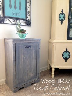 Wood Tilt-Out Trash Can Cabinet. Made with slightly modified Ana White plans and stained to look like old-barnwood. No more ugly trashcan in the kitchen!