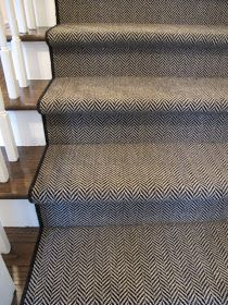 Love the carpet runner. I love anything herringbone. | dark floors, white spindles and risers