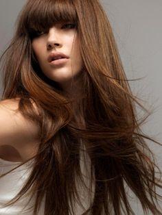 eyebrow sweeping bang and long brown hair