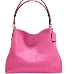 """NWT 🔶 COACH Pebbled Phoebe Shoulder Bag Beautiful  """"Dahlia"""" pink pebbled leather with gold tone hardware. 3 main lined compartments; center zips shut and outer have a magnetic closure Interior zippered pocket, multifunction slip pockets, pen slip •Pebble leather  Silver tone hardware •Inside zip, cell phone and multifunction pockets •Center zip compartment •Magnetic snap closures,  Fabric lining •Handles with 11"""" drop •13.5 x 11.5 x 5.75 in Coach Bags Shoulder Bags"""