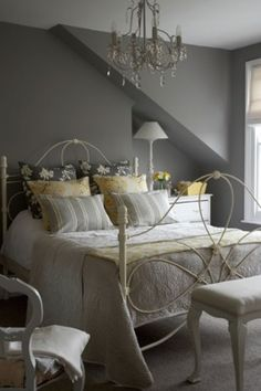 Soft Colour Palette of Grey with slight brown undertone and Off White Accessories that have a cream undertone to bring that warmer element into the space