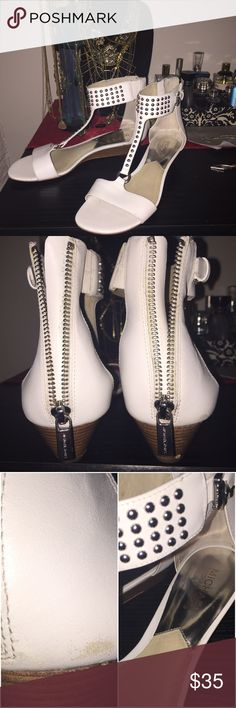 Michael Kohrs. White sandals with small wedge. . Worn twice. Too loose for me. Size 8. But could fit 8.5. I am a true size 8 and these were a tad long for me, by half an inch. Zipper back. Slight scuff on heel, as pictured.But not too noticeable.Could be polished with shoe polish. Some wear on soles.Wooden wedge heel that's about 1.5 inch.Great condition and perfect with summer dresses or cropped skinnies. Accept reasonable offers. No trades or holds please. These are authentic. Purchased…