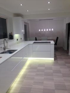 Modern kitchen/diner   Miele induction job   Miele downdraft extractor fan   Amtico flooring   white gloss cabinets   downlighting