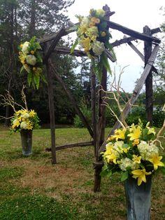 sunshine yellow ceremony set-up - hydrangea, lilies, spray roses and sword fern